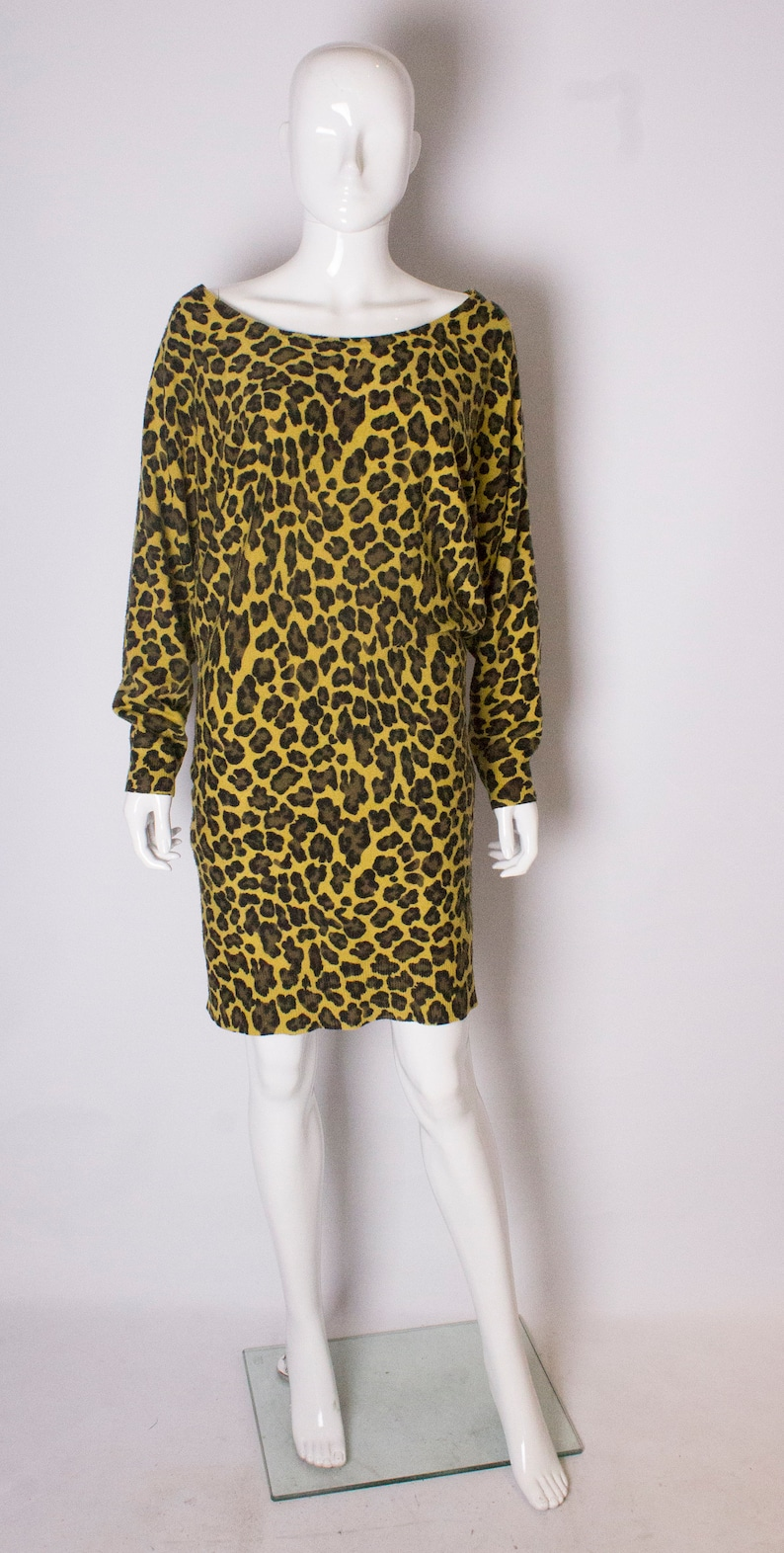 cce5a4226e A Vintage 1980s Betsey Johnson Animal print Sweaterdress