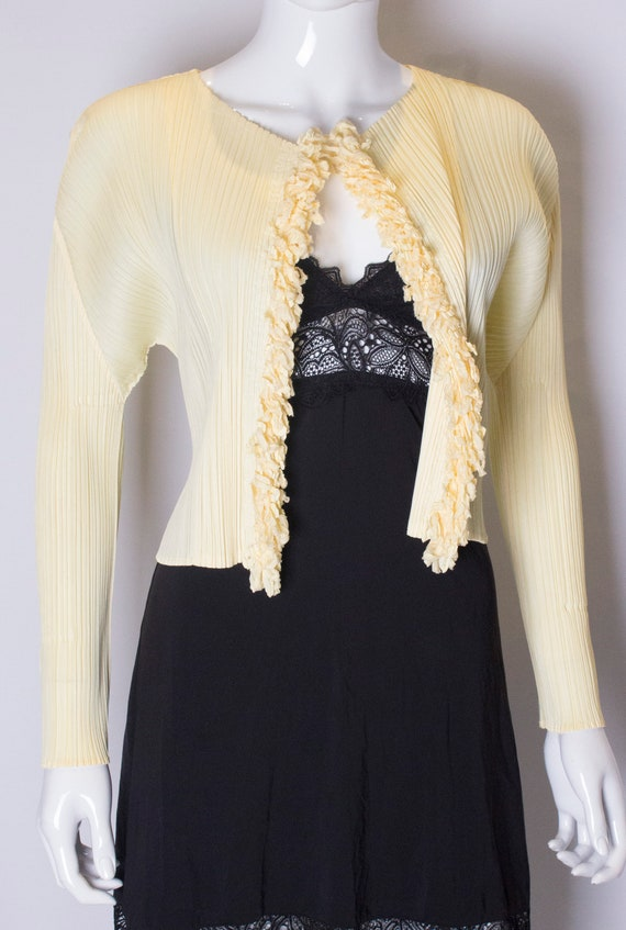 A vintage 1990s Miyake Pleats Please Yellow Cardigan Jacket