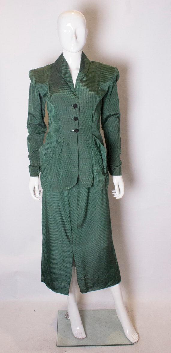 A Vintage bottle green 1940s Skirt Suit