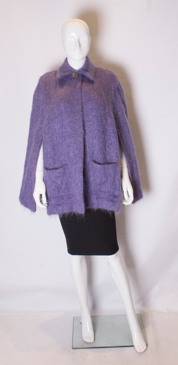 A Vintage 1970s Lavender Mohair Cape by Andrew Stu