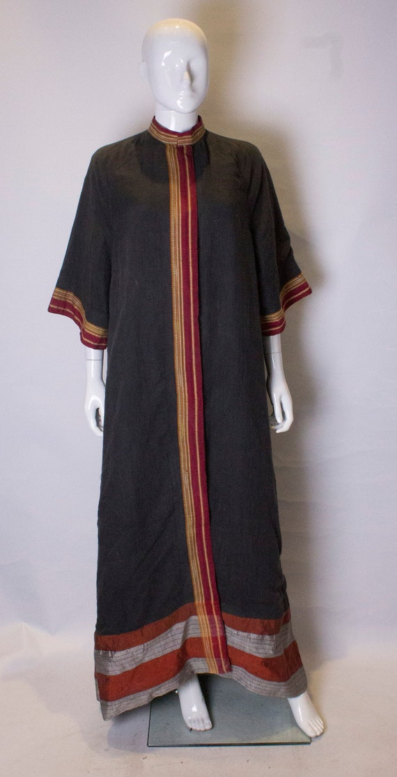 A Thea porter floor length jacket in black and st… - image 1