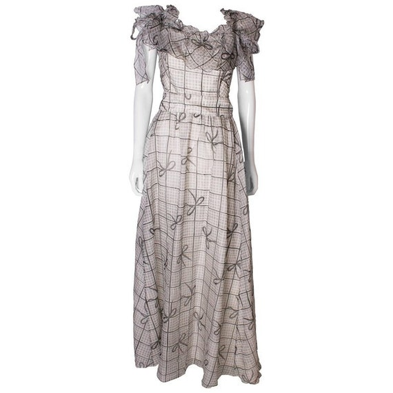 A Vintage 1970s grey printed silk evening gown by