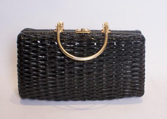 A vintage 1950s - 1960s balck wicker shiny box bag