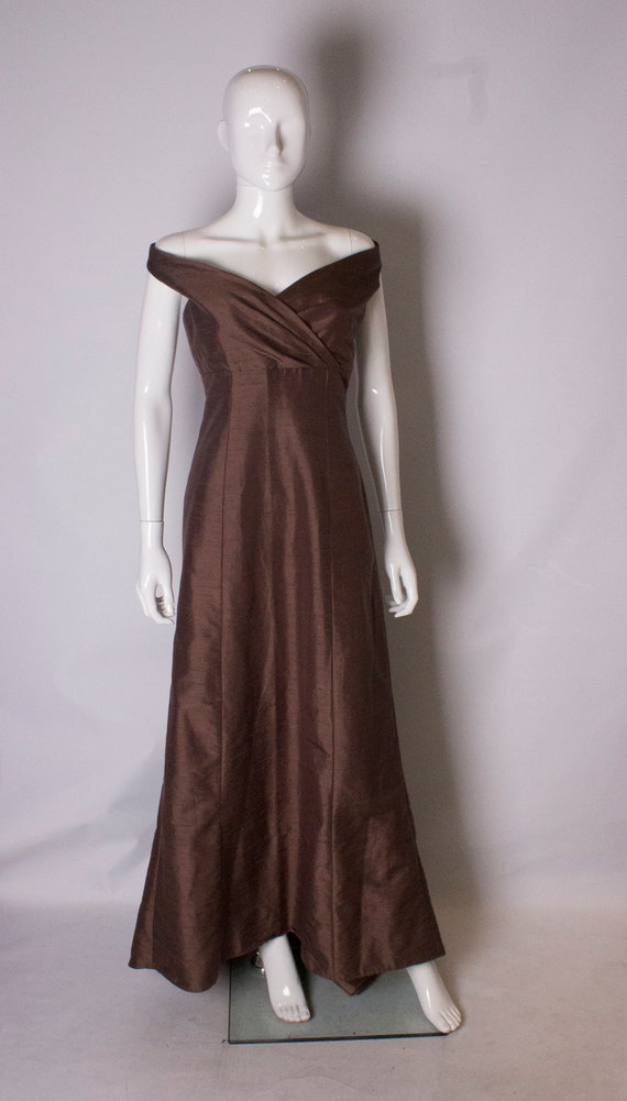 A vintage 1980s brown gown with train