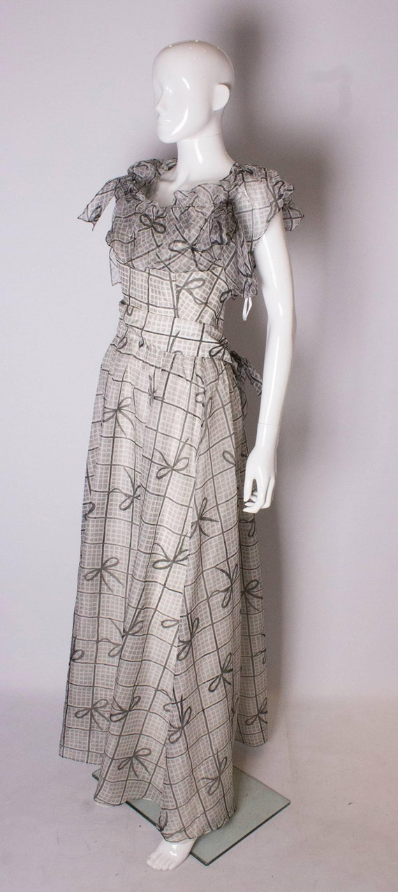 A Vintage 1970s grey printed silk evening gown by… - image 3