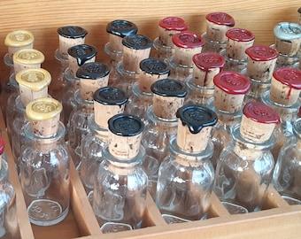 Set of 3 vials with sealed corks