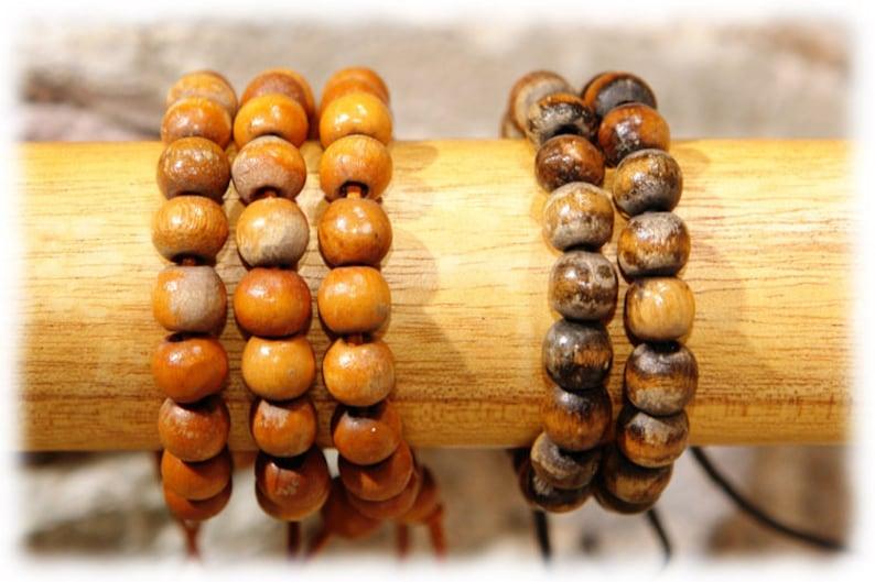Aged wooden beaded bracelet orange/medium brown image 0