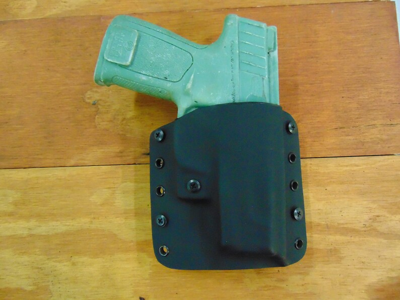 Smith and Wesson SDVE 9mm/40cal Outside the Waistband Holster Right Hand