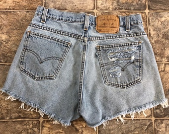 f37bced0 Vintage 80s 90s Lightwash Distressed High-Waisted Silver Tab Levis 505  Cutoff Shorts