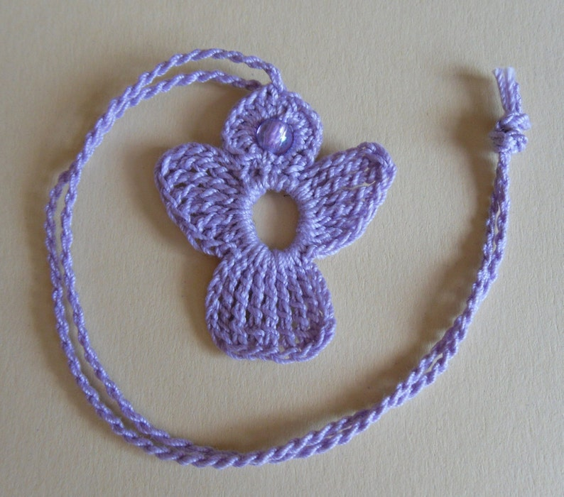 crochet Angel in lilac with light lilac bead