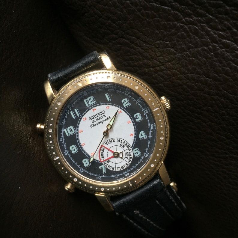 brand new 1042e 63832 SEIKO QUARTZ Age Of Discovery Chronograph Alarm Men's Watch 8M25-8000