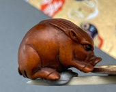 1 Hand carved Boxwood ojime of a pig, wood boar bead, year of the boar, signed by artist