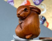 1 Hand carved Boxwood ojime of a rabbit, wood bunny bead, year of the Hare, signed by artist