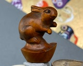 1 Hand carved Boxwood ojime of a rabbit with a gold nugget, wood bunny bead, year of the Hare, signed by artist