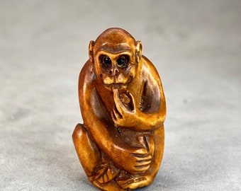 wood monkey bead symbol of prosperity and wisdom year of the monkey One hand carved boxwood ojime: Monkey signed by the artist