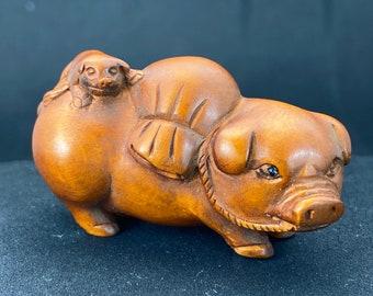 Vintage cherry Amber Japanese netsuke with pig design