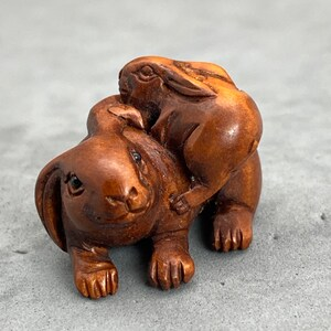 signed year of the hare hare One hand carved boxwood ojime: Mother and cub bunny wood rabbit charm rabbit kimono accessory toggle