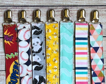 Themed fabric Pacifier clip, boy pacifier clip, binky clip, girl pacifier clip Baseball,Football,superhero,rainbow, panda, bees, waves