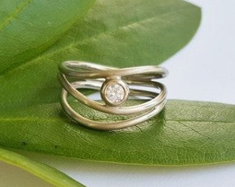 Brilliant wave ring in 585 white gold engagement goldsmith's work