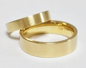 handmade TRAURINGE in 750 yellow gold modern shape goldsmithing