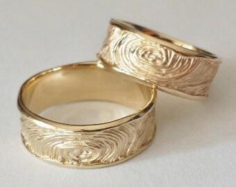 Wedding rings made of 585 rose gold fingerprint relief pattern tree rings goldsmith's work