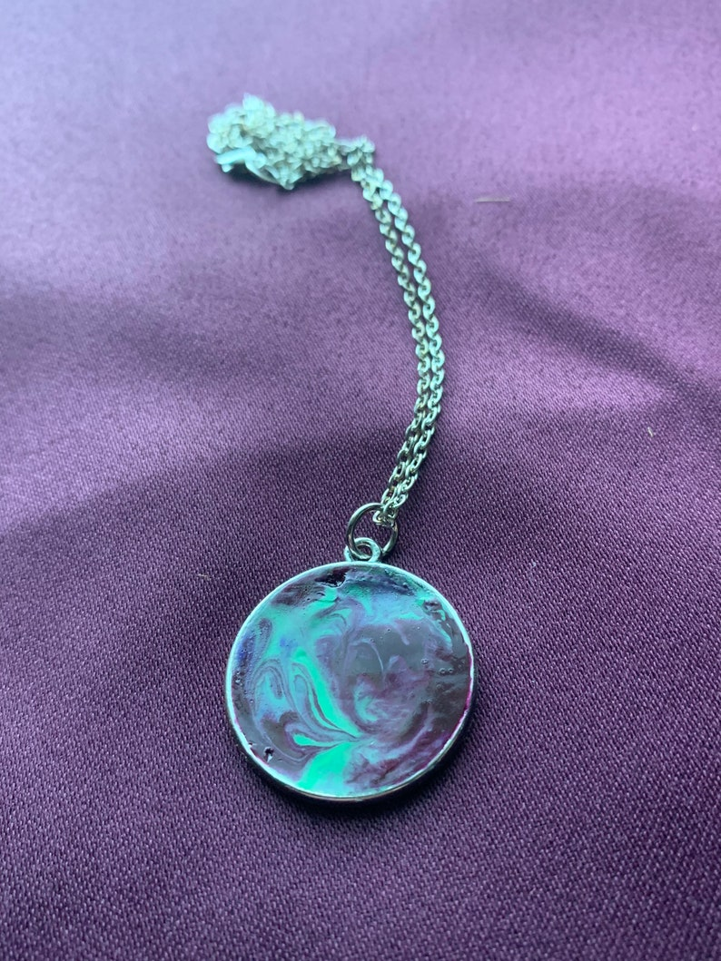 Purple and turquoise crayon pendant