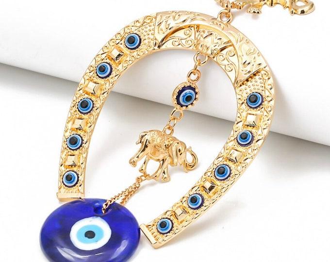 Featured listing image: Evil Eye Gold Wall Hanging, Evil Eye Wall Decor, Evil Eye Horseshoe and Elephants, Blue Greek Evil Eye, Good Luck, Protection, Kabbalah