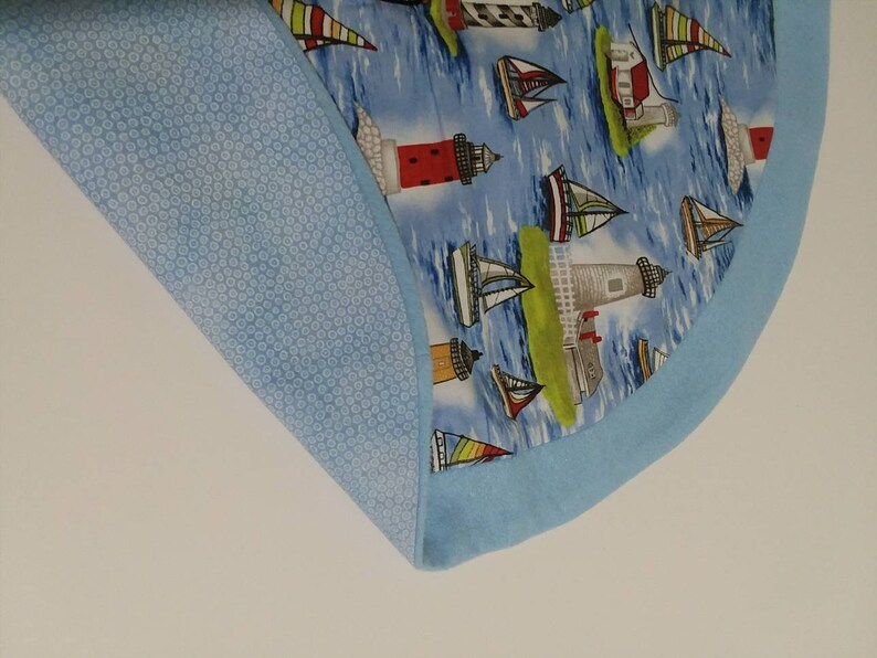 For the nautical lovers this 19.5 tabletop tree skirt would be something your friends would talk about.