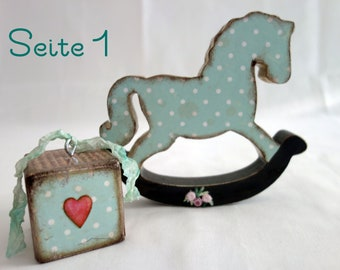 Small wooden horse, wooden cubes in retro vintage shabby chic style