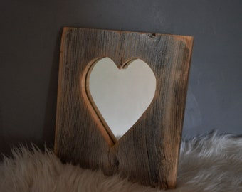 Mirror image in heartwood frame