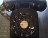 Vintage black rotary telephone, retro table phone
