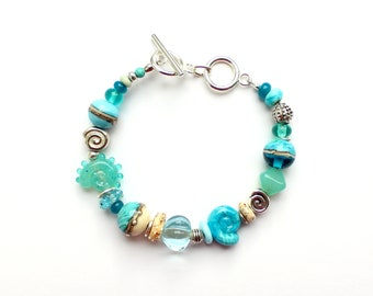 """Bracelet """"Holiday by the Sea"""", glass beads, silver, ammonite, light turquoise, lampwork, handmade by PERSICO"""