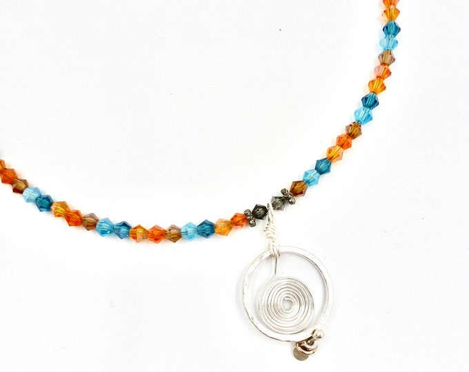 Silver Spiral Ring Pendant Blue and Orange Beaded Necklace
