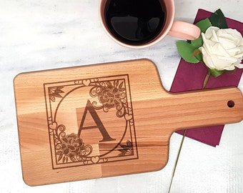 Breakfast board with handle with angular monogram letter with flowers and hearts laser engraved 15 cm x 30 cm