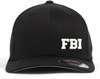 cf7a0ca1b67 FBI Text Embroidered Flexfit Baseball Cap Hat Black Flex Fit S M   L XL  Unique Design