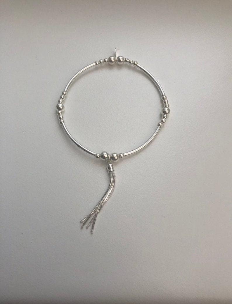 Sterling Silver Noodle Bracelet with Tassel Charm image 0