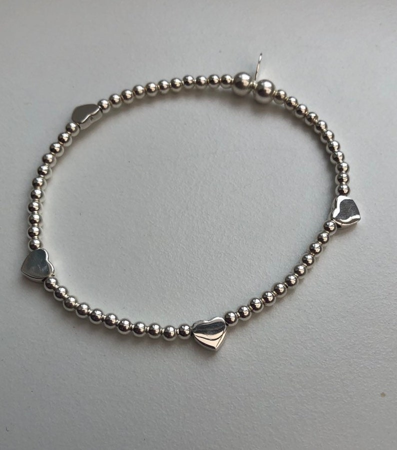 Sterling Silver Bracelet with Hearts image 0
