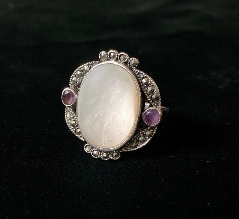 purple stone inlays and large mother-of-pearl set in the centre T 6264 Vintage silver 60s ring with silver oval cabochon
