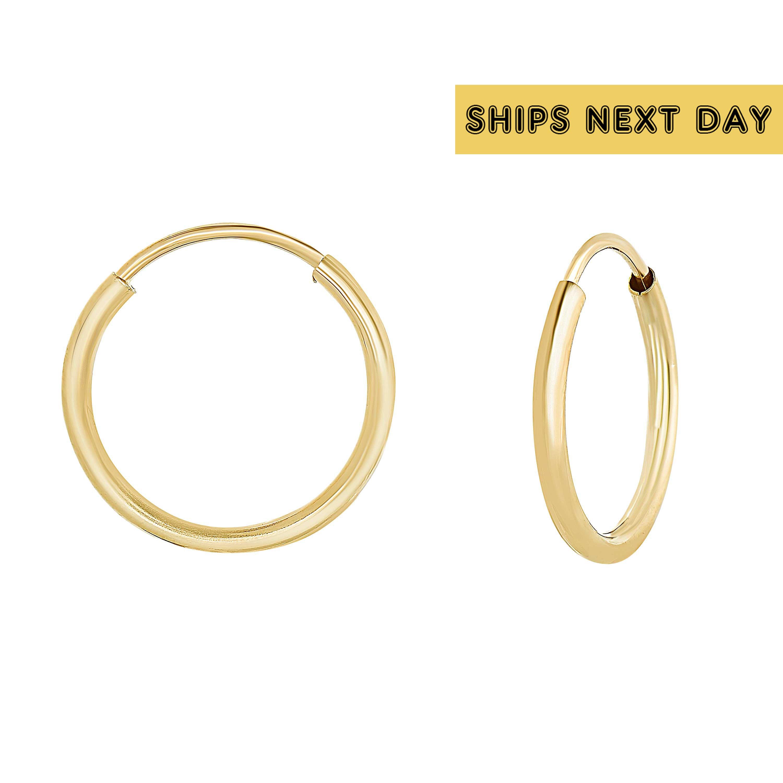 18mm x 10mm 14k White Gold Cubic Zirconia Huggies Earrings,