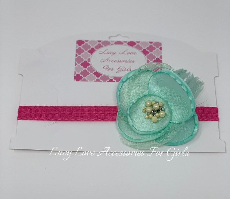 Beautiful headband and colors wirh gorgeous beading Perfect to accessorize in style! Turquoise flower headband with pink band