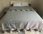 moroccan pom pom blanket, Gray handwoven pom pom blanket