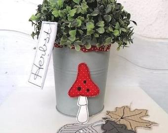 Embroidery file mushroom pendant