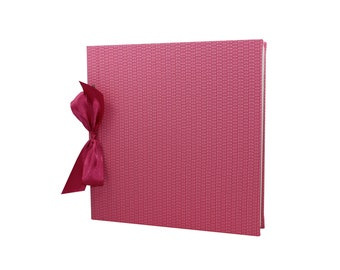 Photoalbum with strap binding and bow Marie
