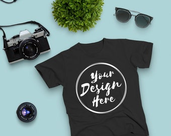 7e3c259aff638 Black Bella Canvas 3001 Tshirt Mockup With Camera and Sunglasses On ...