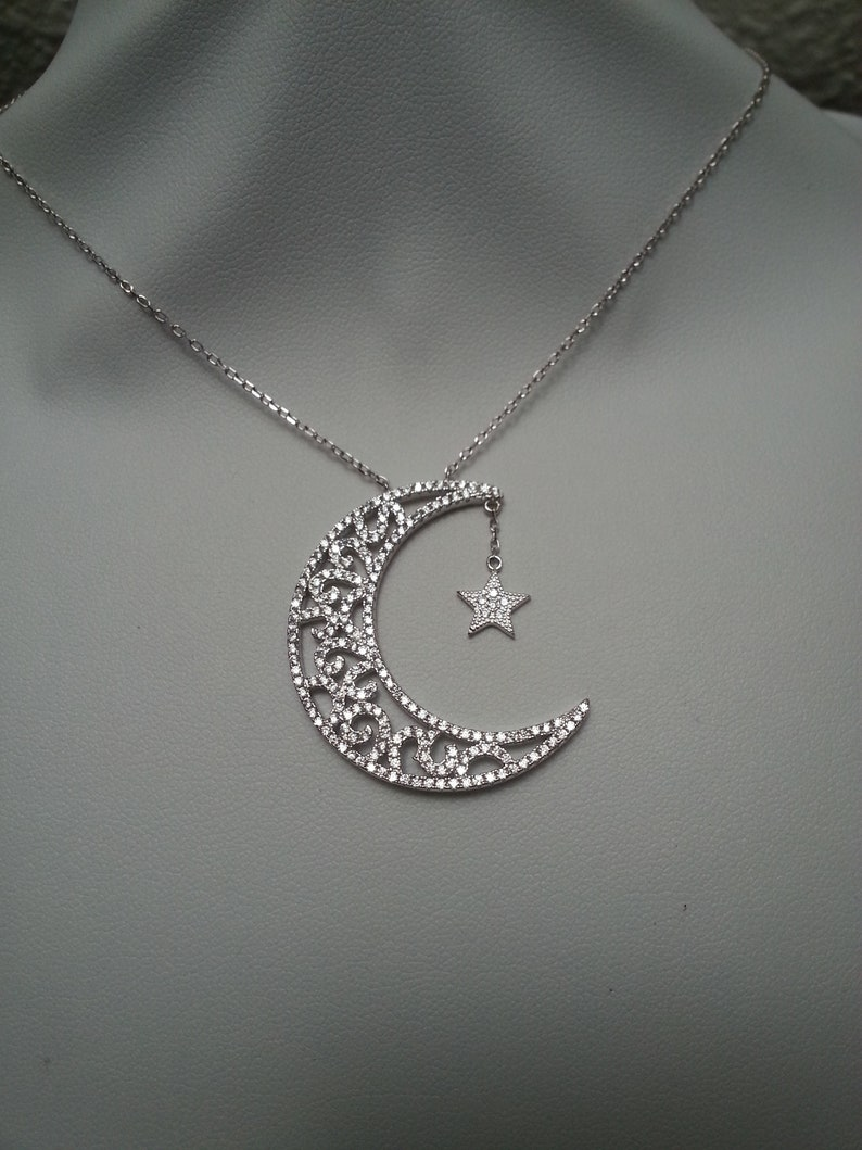 matching chain Elegant sterling silver moon and star pendant sparkling cubic zirconia crystals swirls graceful loving magic gift