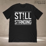 Still Standing T-Shirt | Disability Gift for Veterans, Handicapped Humans + Strength Quote Fan | Unisex Tee, Tank Top, Hoodie, Mug