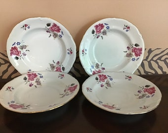 Vintage Set of Four Porcelain Plates
