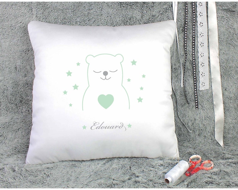 light green and gray Fabric embroidered in white cotton with a teddy bear and a name