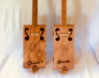 3 string  fretless Cigar Box Guitar. On exhibition, NOT FOR SALE