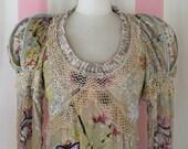 Devoré floral velvet long sleeved boho dress adorned with butterfly appliqués and Elizabethan shoulder rolls.